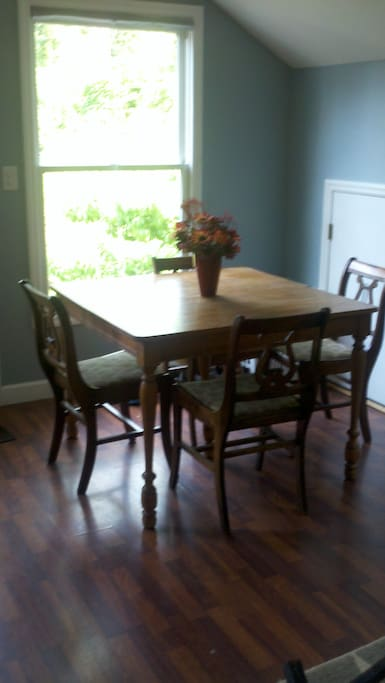 Comfortable dining area, seating for 7 adults. Folding wooden chairs are stored in closet by vanity.