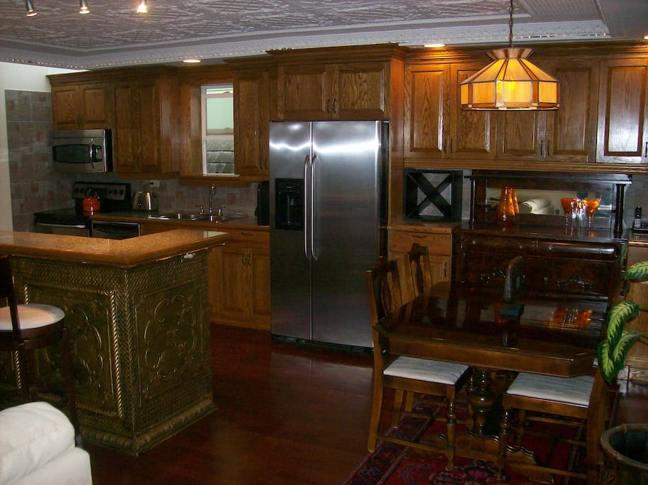 Fully equipted kitchen with stainless appliances