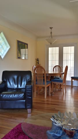 Dining room has French Doors into south facing sunroom.