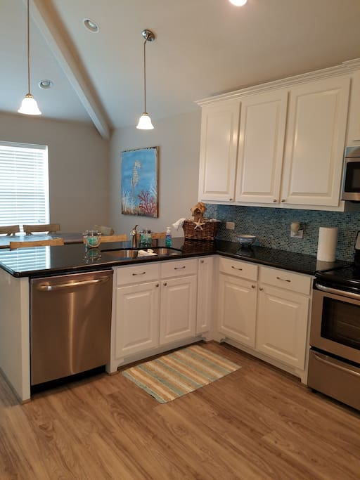 Kitchen is clean with new appliances and fully stocked with pots and pans, utensils, coffee pot, crock pot and much more!
