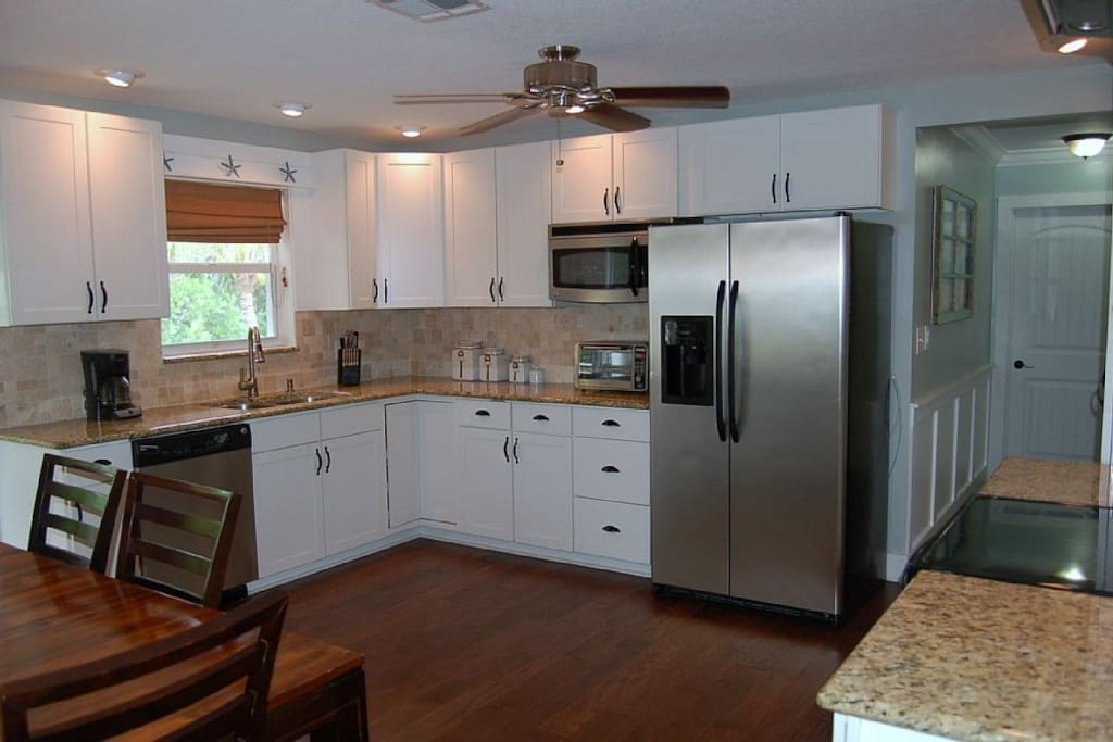 Kitchen with granite tops and stainless appliances
