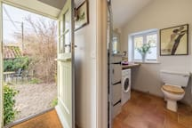 Ground floor:  Utility room with washer/dryer, wash basin and WC