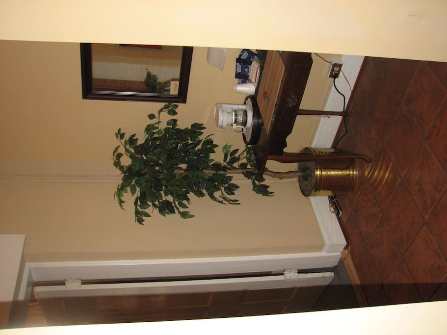 (Sorry this picture is laid on it's side.)  Entrance way to Room C. One of the large closet's is in this area.