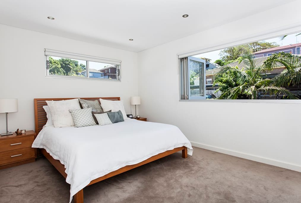 Master bedroom (bedroom 1), kingsize bed with bi-fold windows, for cool breezes and fitted wardrobes. Upstairs.