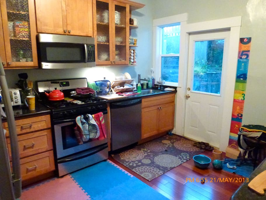 Gourmet kitchen with dishwasher, microwave, toaster oven - back door leads to shared back yard
