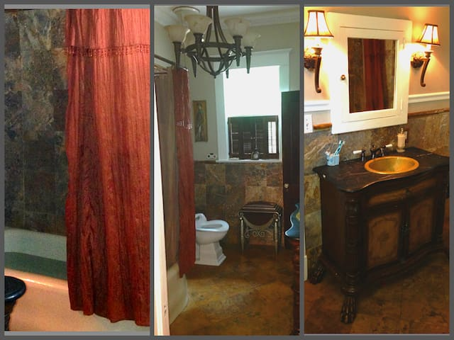 Old world charm! Enjoy a soothing bath in this marble & onyx bathroom with tub/shower. Great window with plenty of sunlight. Luxurious bath towels provided for your comfort. Complimentary bath salts, scrubs and lotions are at your disposal.