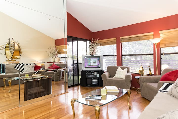 Mirrored wall with gas fireplace that lights at touch of a button, wraparound patio with balcony