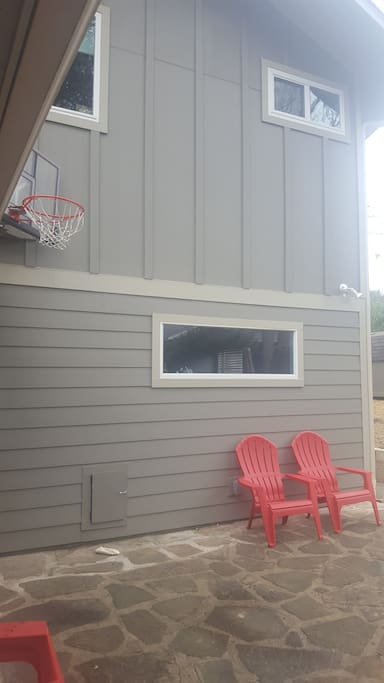Backyard patio including basketball.