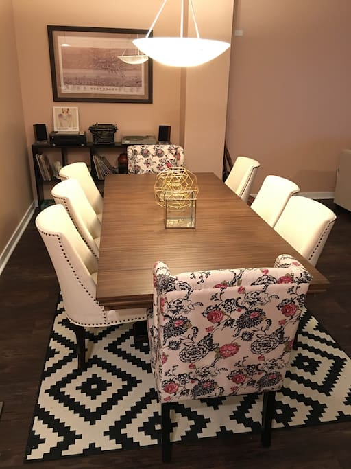 Dining room table can serve as workspace for up to 8 people, comfortably. High speed wifi and cable included