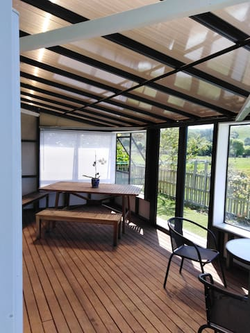 North facing deck, now semi-enclosed for adverse weather, with rural views. There is a bird sanctuary nearby, so you may see pheasants, plover, geese, swans, ducks, Pukeko, Tui, and an occasional hawk. We normally serve your breakfast here.