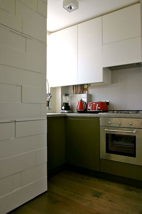 Custom built kitchen means max usefulness with no wasted space