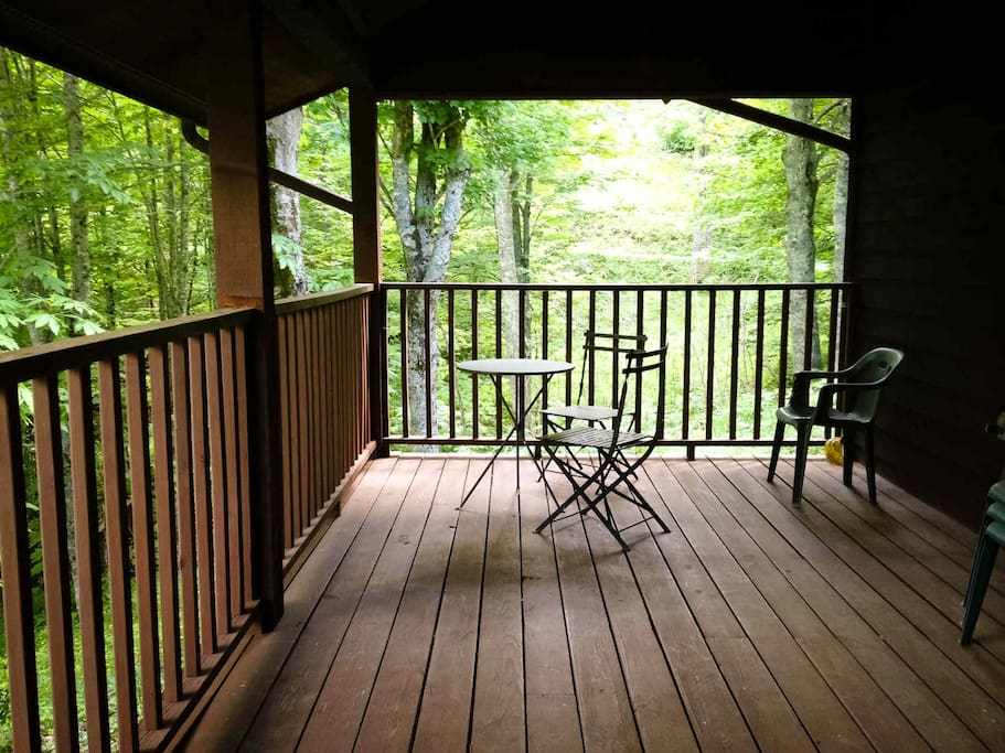 Back porch. Runs the length of the cabin. Walkway to pond and stream. Photo credit: H. Johnson