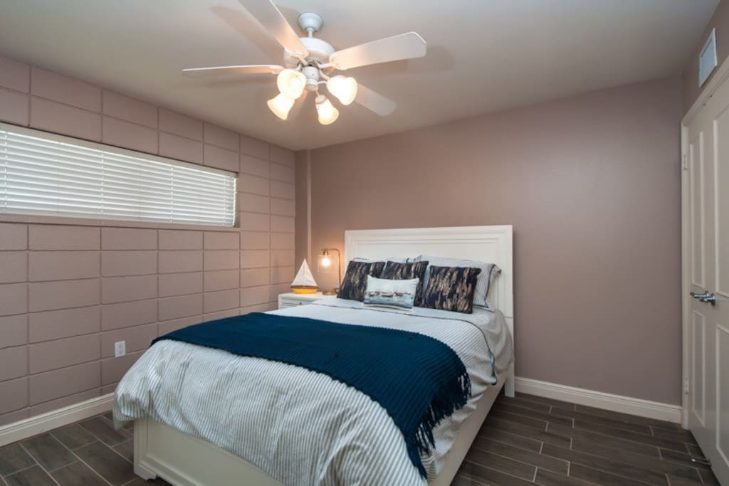 The second bedroom with a queen bed.