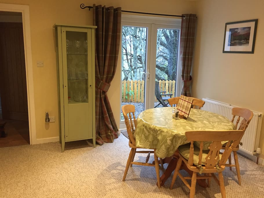 Dining area with French windows onto private garden