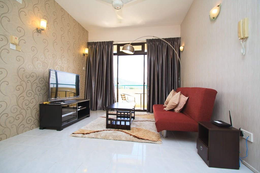 A spacious living area with a comfortable sofa while enjoying various programmes from ASTRO on this new beautiful SMART TV