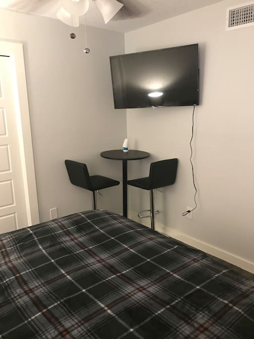 Smart TV with WiFi, plus table and chairs