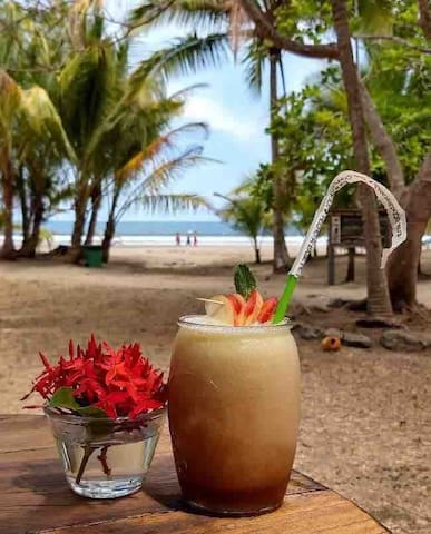 Enjoy a cocktail at our beautiful beachfront Beach Bar & Grill