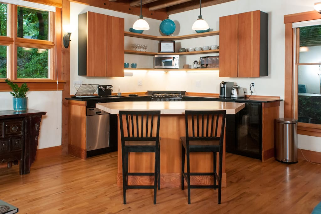Open kitchen with butcher block counter to work or relax with morning coffee