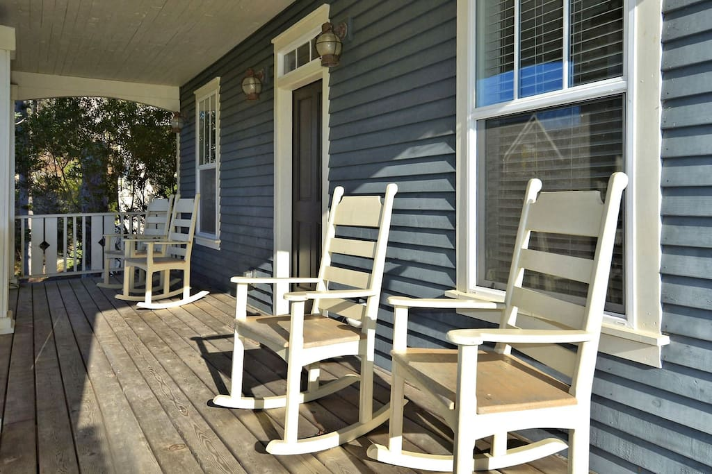 Front porch with four rocking chairs