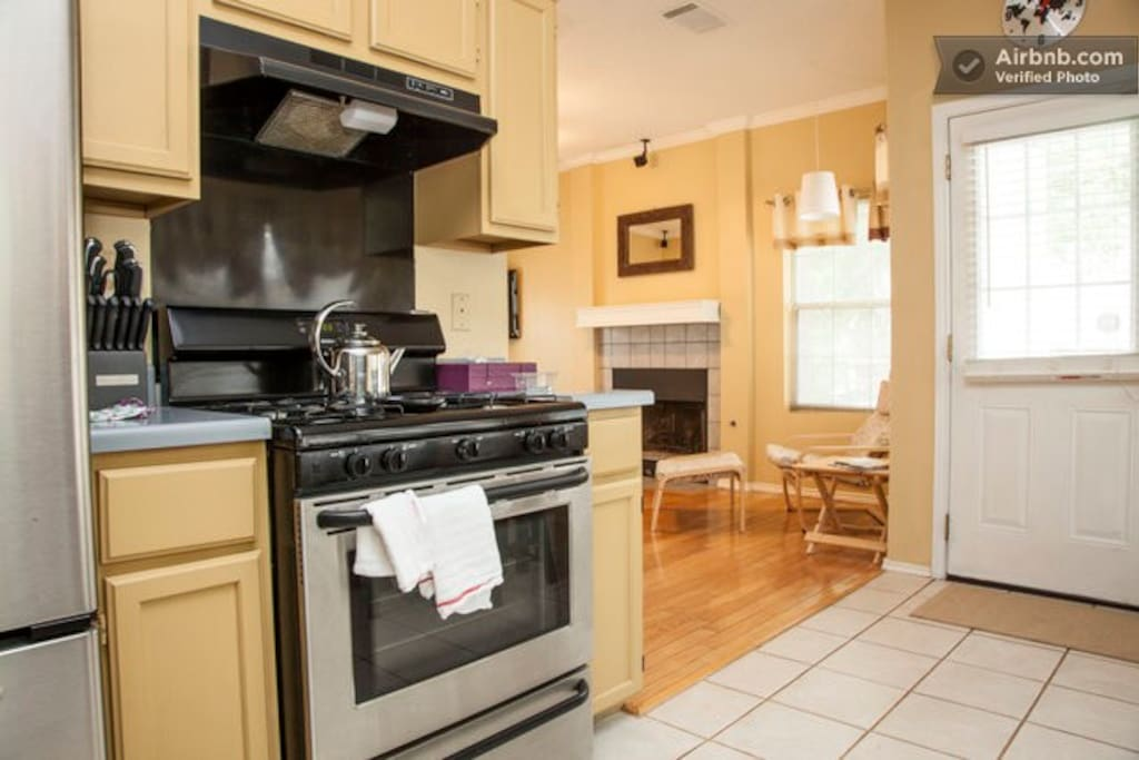 The kitchen features stainless appliances with gas stove.