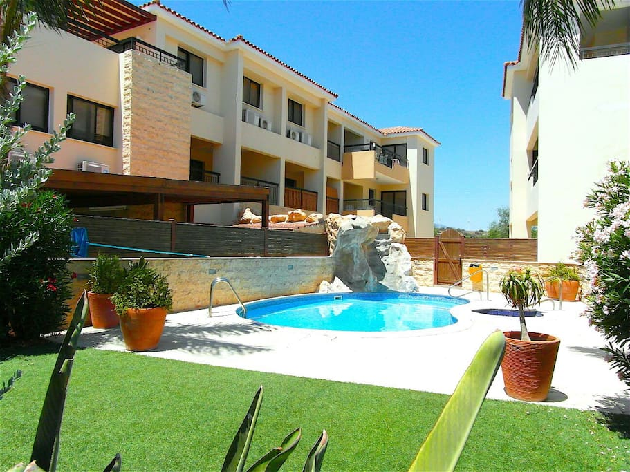 Waterfall, Pool, Jacuzzi & Gardens, with Waterfall running off Apartment Balcony
