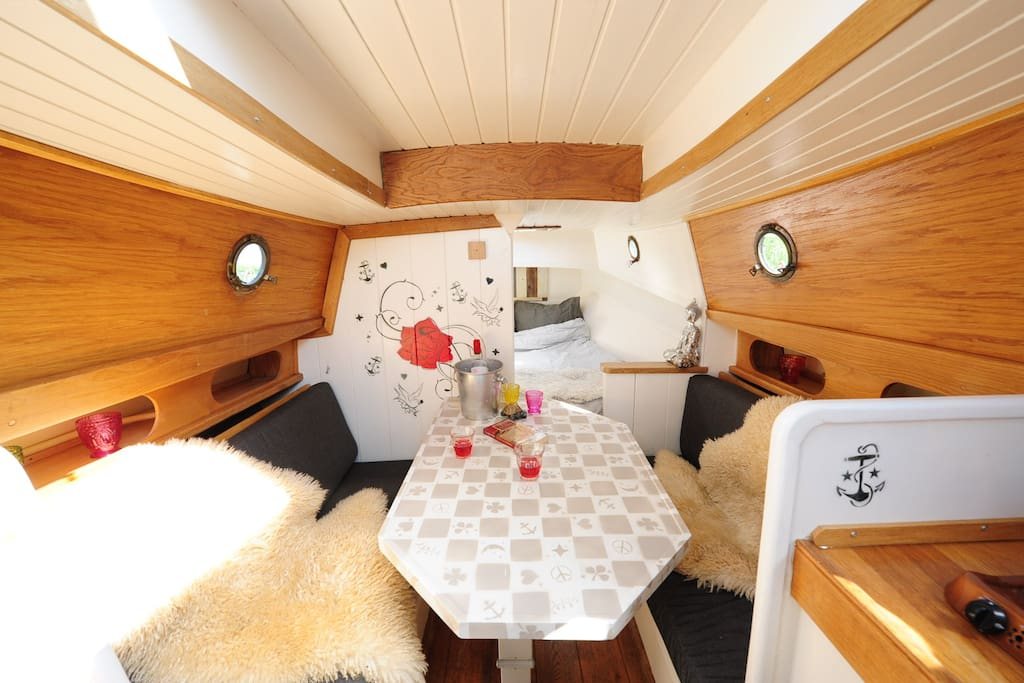 the interior of the boat, kitchen, living room and bedroom in one, camping on the water is fantastic