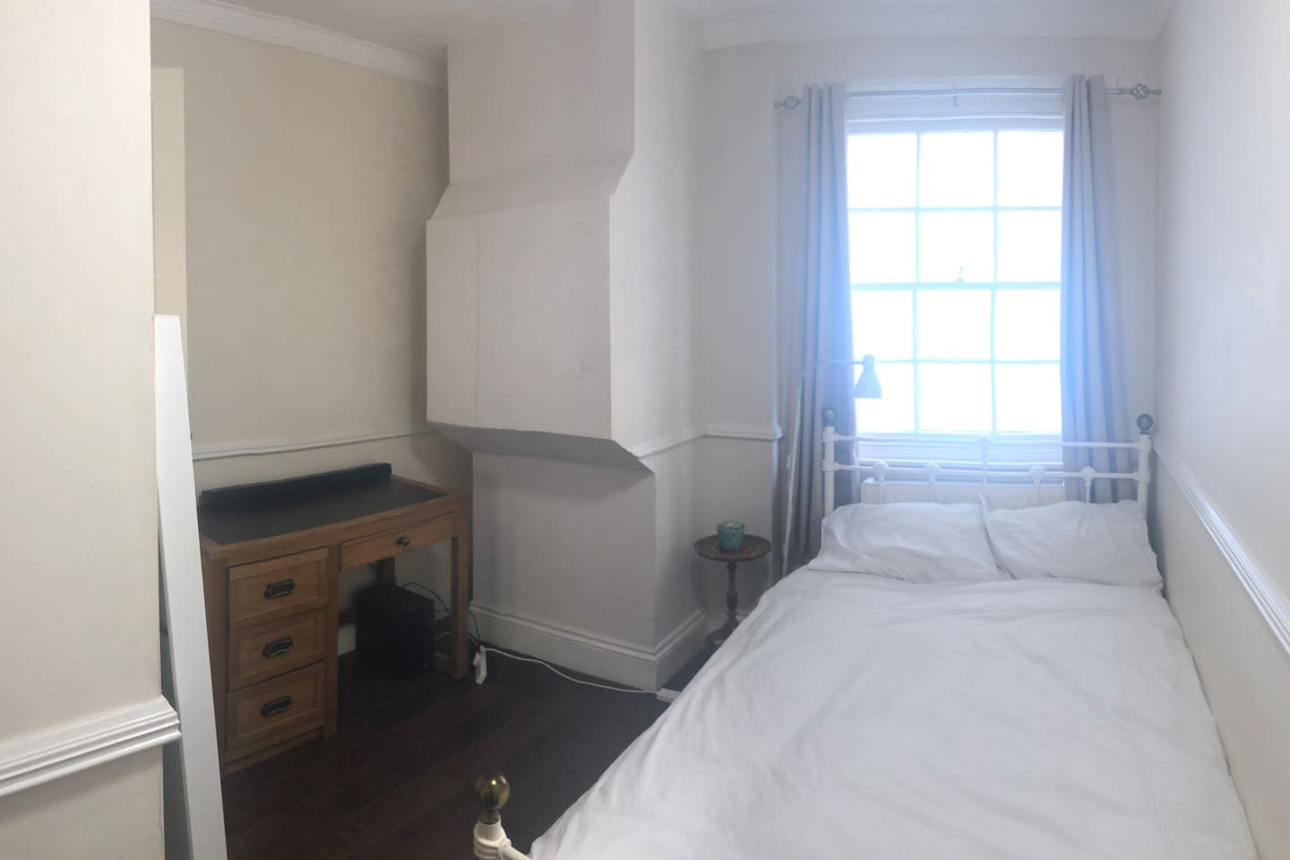 A double bed and desk