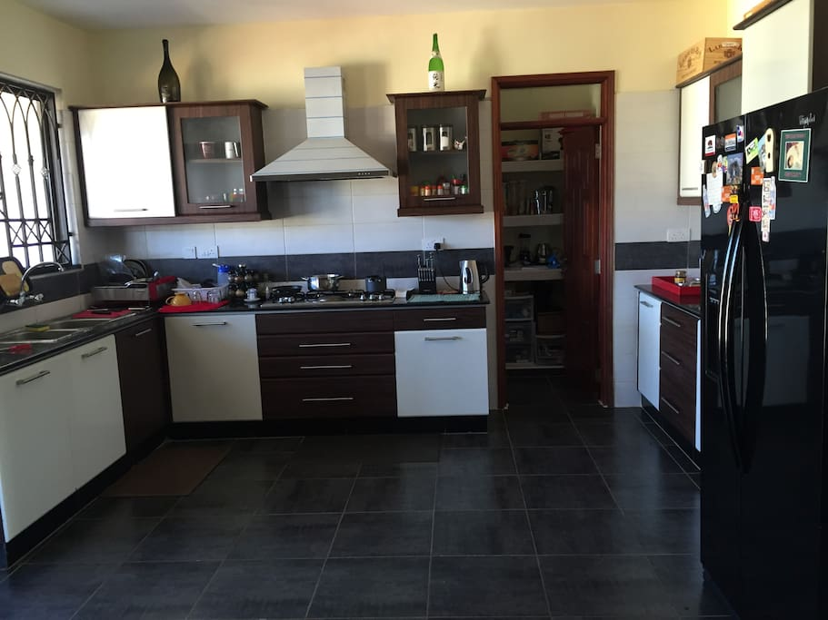 Large Spacious Kitchen with Gas Burner and Hood , Separate Oven & Large Whirlpool  Doubledoor Refrigerator.