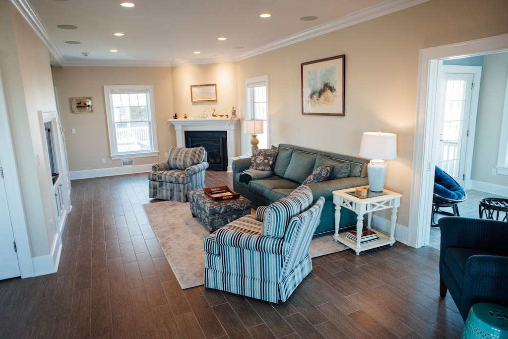 The family room features comfortable seating and a gas fireplace for cooler nights.