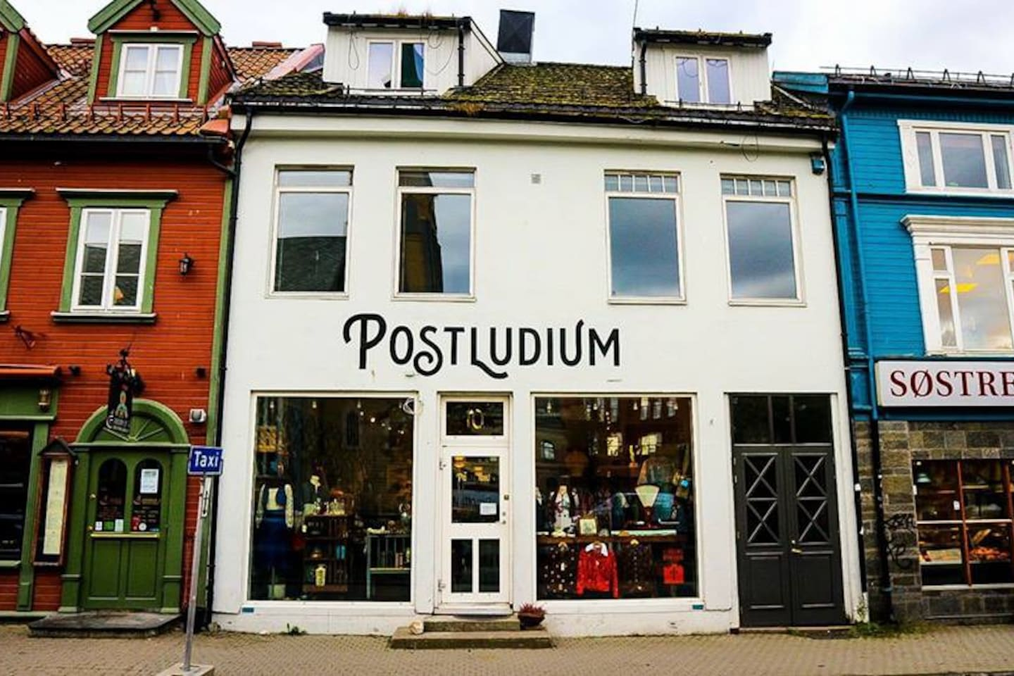 Postludium, Kirkegata 10, in the heart of Tromsø. In first floor our secondhand shop.
