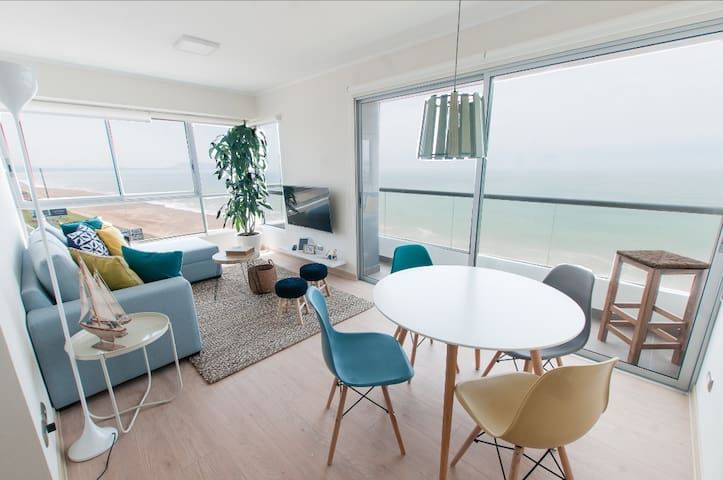 Enjoy Sunsets at Bright Oceanfront Apartment