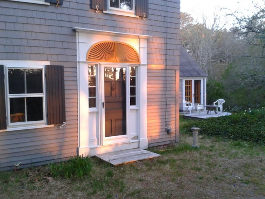 Sunset glow: Captain's house with kitchen wing and deck