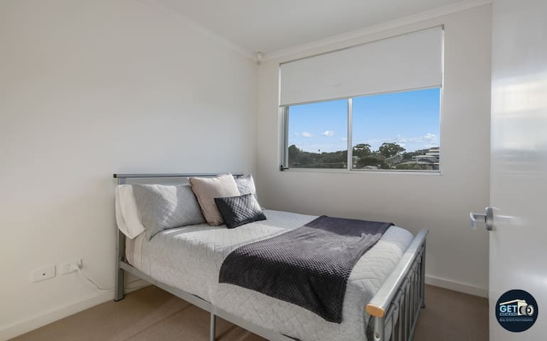 Rear bedroom with double bed and built in cupboards.  Views over swimming pool & tennis court.