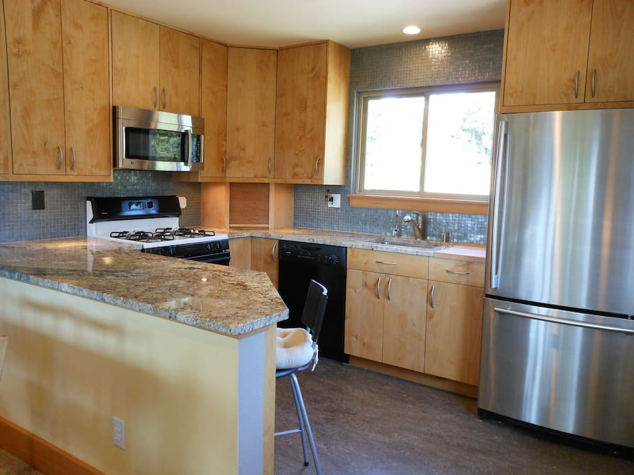 Modern kitchen and appliances for meal prep.