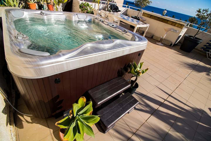 Large private Jacuzzi (spa) for 6 persons with a sea view.