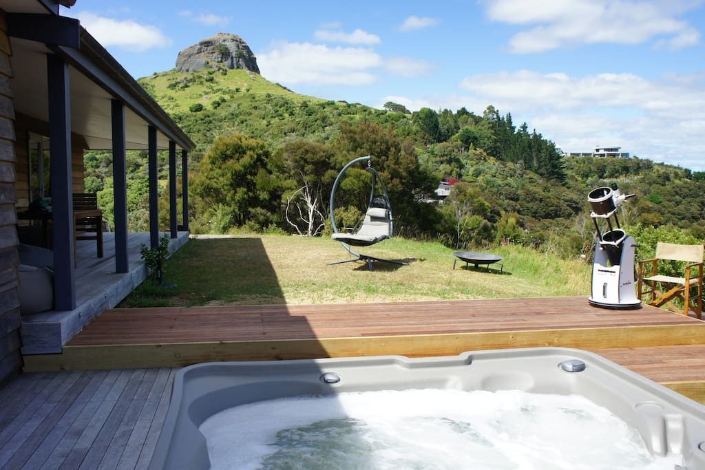 Spa pool with view to St Paul's Rock aka Ohakiri; with night sky telescope