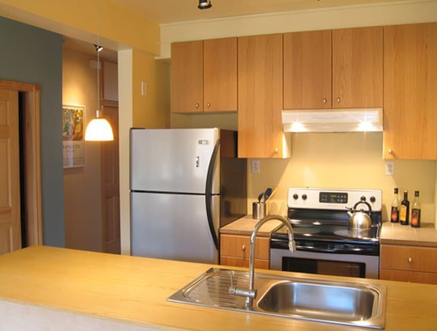 The open kitchen with modern appliances - everything to cook your favourite dinner
