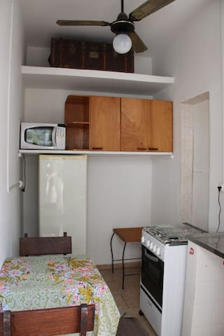 Kitchen with microwave, refrigerator and oven
