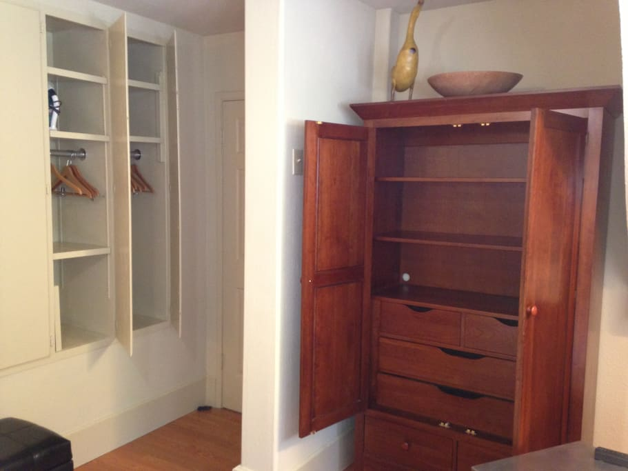 Armoire has shelves and drawers.  Closet spaces with hangers.