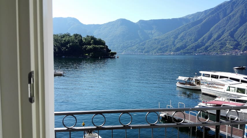 THE HOUSE OF ALMA IN FRONT OF THE ISLAND LAKE COMO