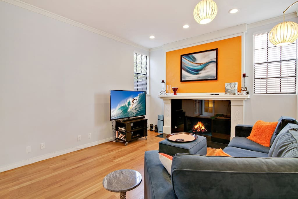 """Relax by the fireplace in the living room and watch a movie on the 60"""" flat-screen TV."""