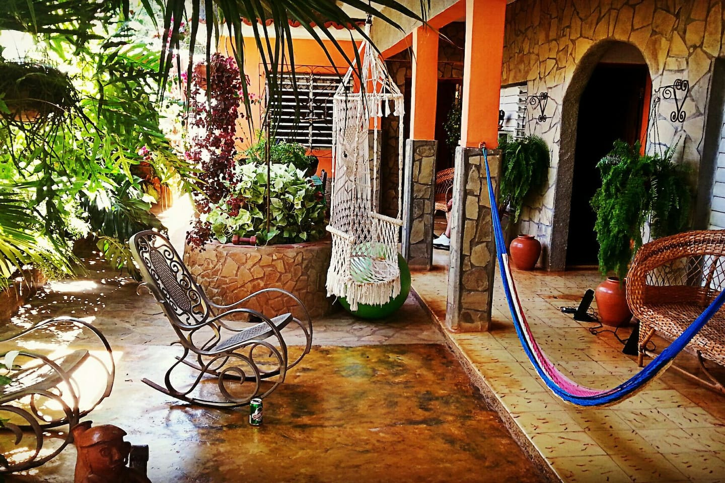 That blue rope is the relaxing hammock, the opening behind it is to the guest rooms, straight ahead is the kitchen,  and on the left is a private entrance to the courtyard.