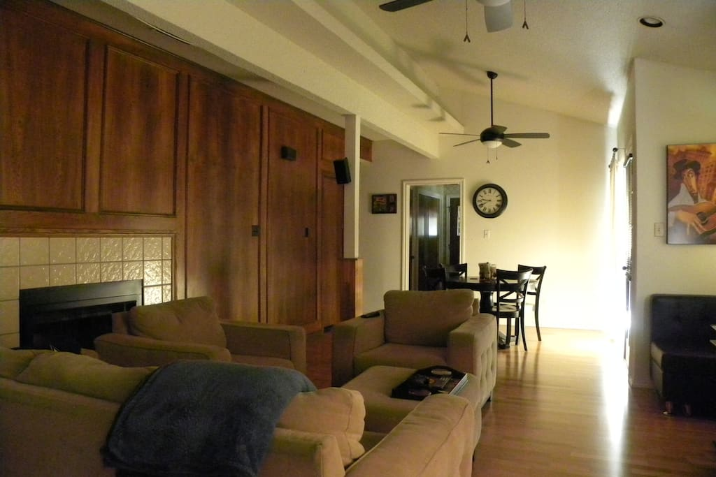 Living area with dining table in back. A 3rd guest could probably sleep on the couch or something.