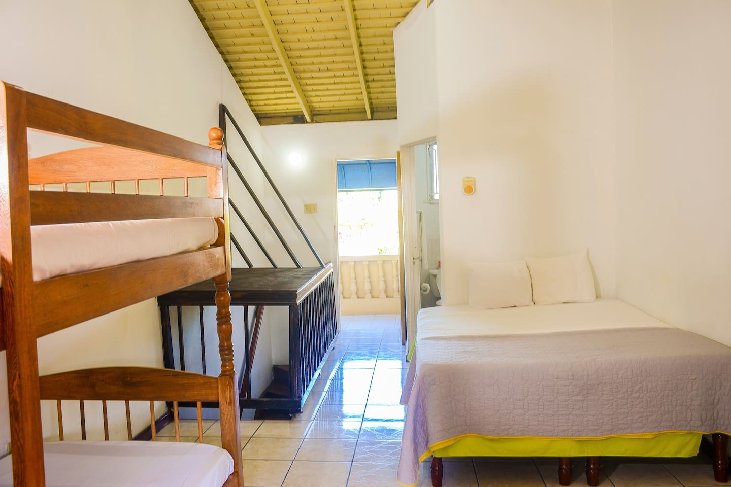 Loft room situated at the front of Reggae Hostel above reception. The room is very basic with no hot water but has ceiling fan and ensuite bathroom. The room is very well ventilated with ceiling fan.  The views are the best feature of the  room.