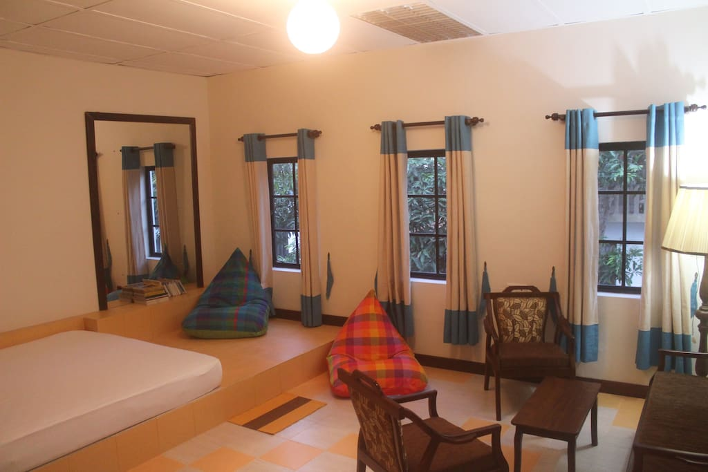 Your room with a view of a lush mango tree