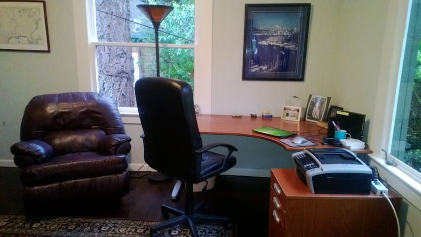 Office with large desk and piano