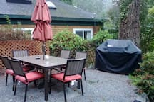 Outdoor dining area with gas grill