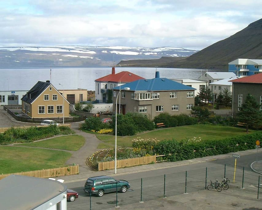 Áslaug's Accommodation - Faktorshús (the yellow house) in Hæstikaupstaður,Ísafjörður, Iceland.  The main Guesthouse is in the grey house with blue roof.