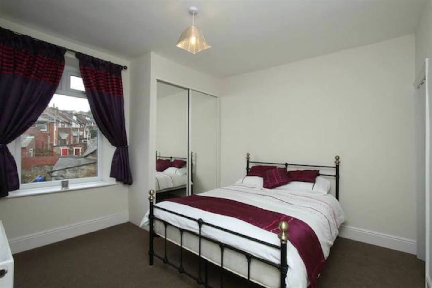 Comfortable double bed, large wardrobe, windows which can be opened, radiator connected to central heating system.