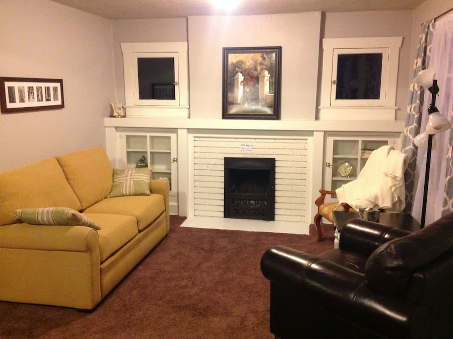 Living Room with Fireplace and sofa bed (memory foam mattess)